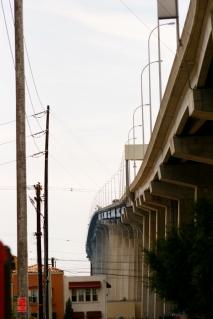 The Coronado Bay Bridge over Logan Heights.